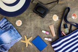 beach-bag-sun-hat-cosmetics-denim-shorts-camera-seashells-76483581