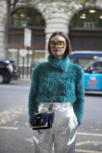 beautiful-and-stylish-a-girl-in-a-green-furry-sweater-made-of-faux-fur-posing-during-the-london-fashion-week-outside-eudon-choi-100475361