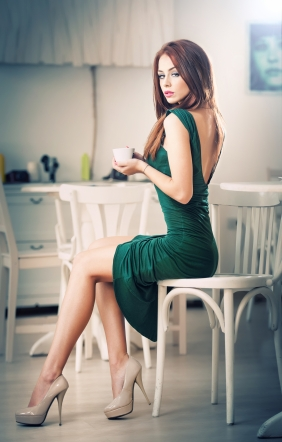 fashionable-attractive-young-woman-in-green-dress-sitting-in-restaurant-beautiful-redhead-in-elegant-scenery-with-a-cup-of-coffee-43365839