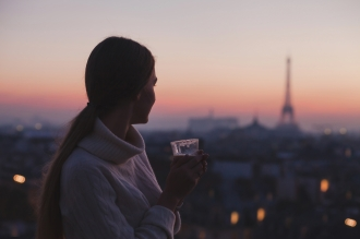 woman-enjoying-night-panoramic-view-of-paris-71984060