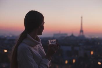 woman-enjoying-night-panoramic-view-of-paris-71984060